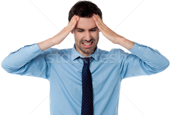 Man having severe headache Stock photo © stockyimages