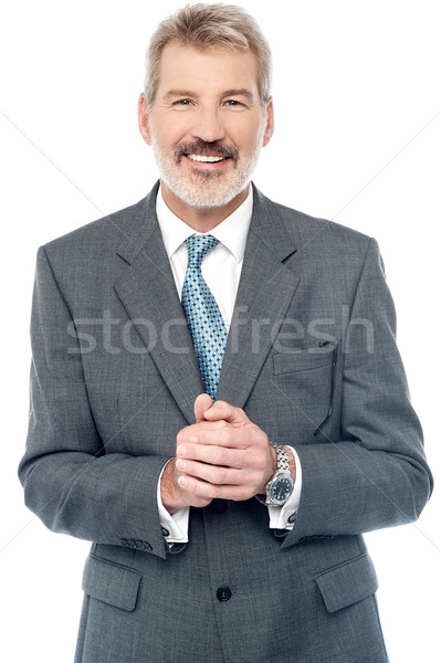 Businessman posing with clasped hands  Stock photo © stockyimages
