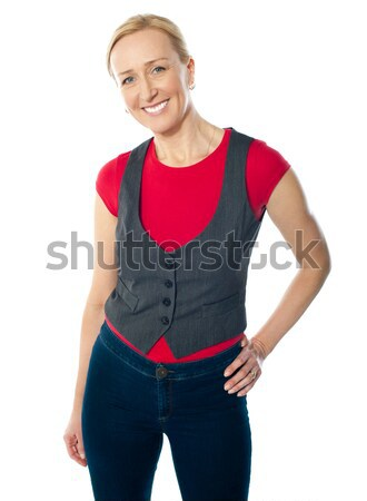 Portriat of smiling gorgeous woman in casuals Stock photo © stockyimages