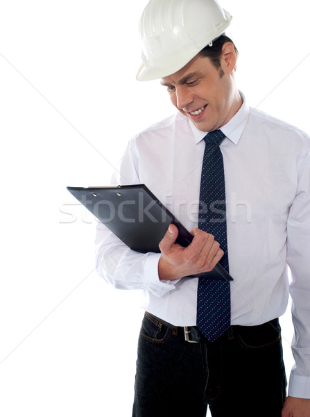 Stock photo: An architect reviewing report