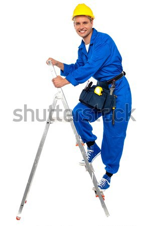 Construction worker climbing up the stepladder Stock photo © stockyimages