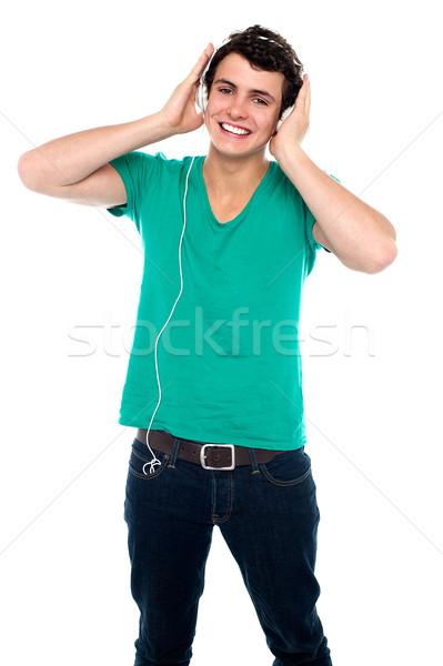 Cheerful guy enjoying loud music Stock photo © stockyimages
