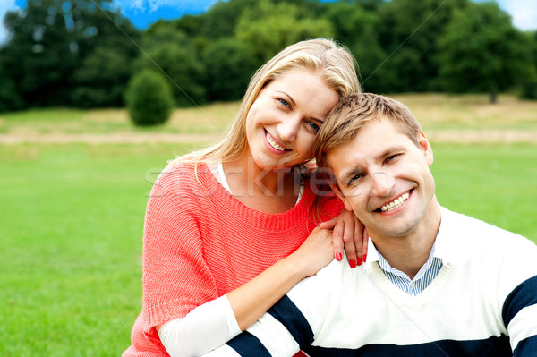 Lovely young couple striking a smiling pose Stock photo © stockyimages
