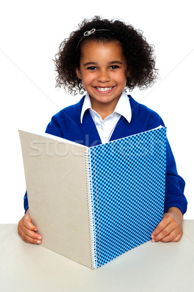 Smiling school girl learning weekly assignment Stock photo © stockyimages
