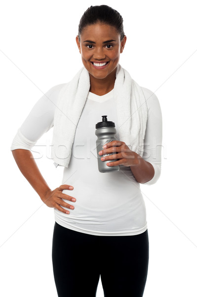 Fitness freak holding sipper, towel around her neck Stock photo © stockyimages