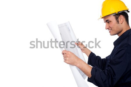 Construction worker reviewing plan Stock photo © stockyimages