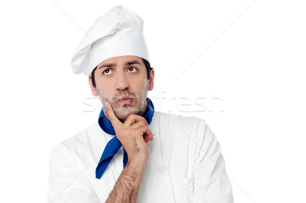 Male chef lost in deep thoughts Stock photo © stockyimages