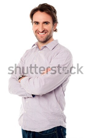 Smart guy posing confidently Stock photo © stockyimages