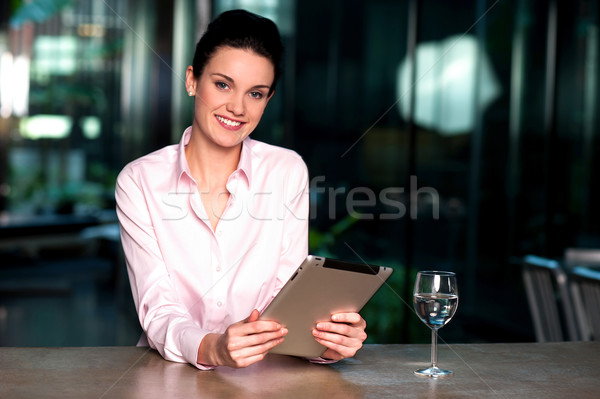 Corporate lady browsing on tablet pc Stock photo © stockyimages