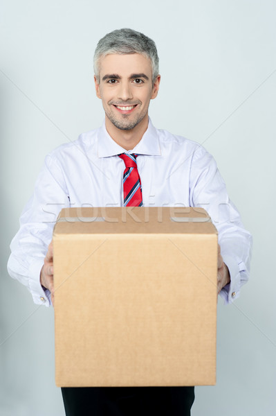 Stock photo: Smiling aged delivery man