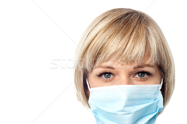 Stock photo: Female doctor wearing surgical mask