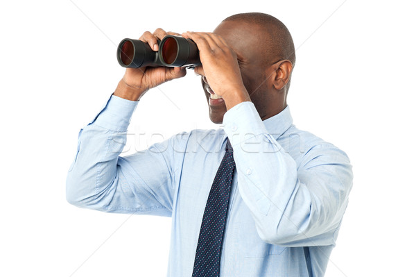 African male using binocular Stock photo © stockyimages