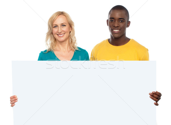 Attractive couple holding white blank ad board Stock photo © stockyimages