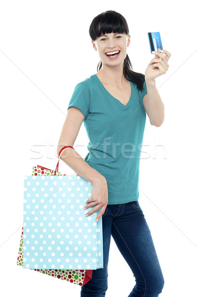 Shopaholic woman holding her cash card up Stock photo © stockyimages