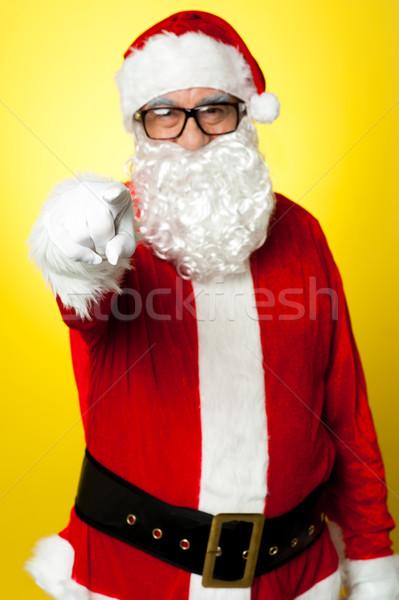 サンタクロース 眼鏡 ポインティング 孤立した 黄色 背景 ストックフォト © stockyimages