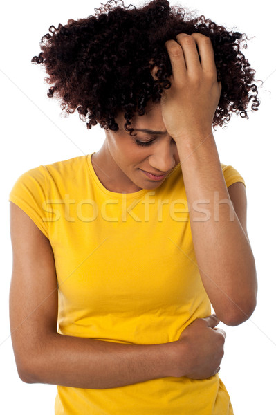 Young woman suffering from headache Stock photo © stockyimages