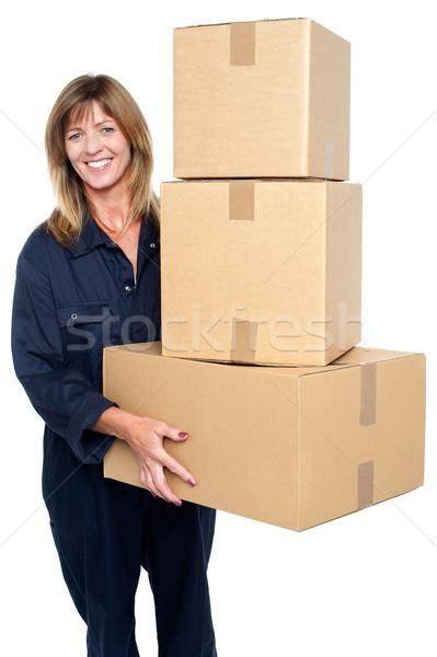 Friendly delivery woman with three packed cartons Stock photo © stockyimages