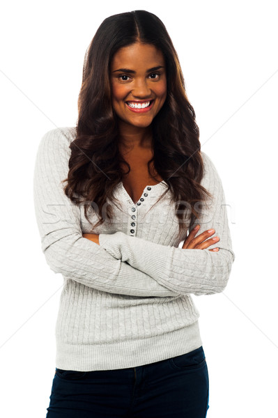 Young smiling woman posing with arms crossed Stock photo © stockyimages