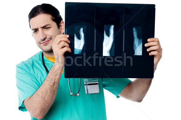 Disappointed surgeon after seeing x-ray report Stock photo © stockyimages