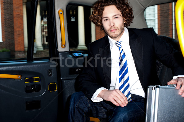 Handsome business corporate inside taxi cab Stock photo © stockyimages