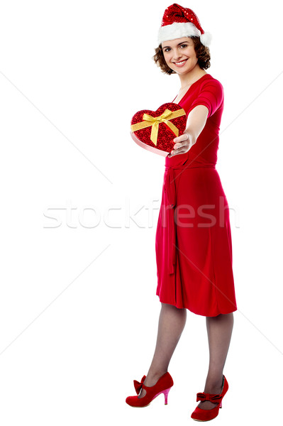 Woman in red giving away xmas gift Stock photo © stockyimages