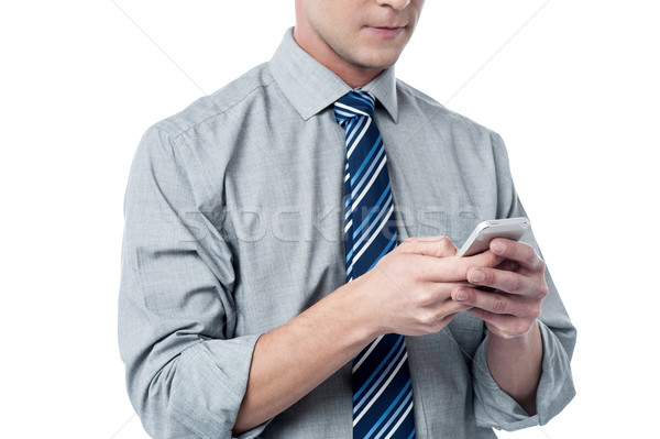 Business executive using cell phone Stock photo © stockyimages