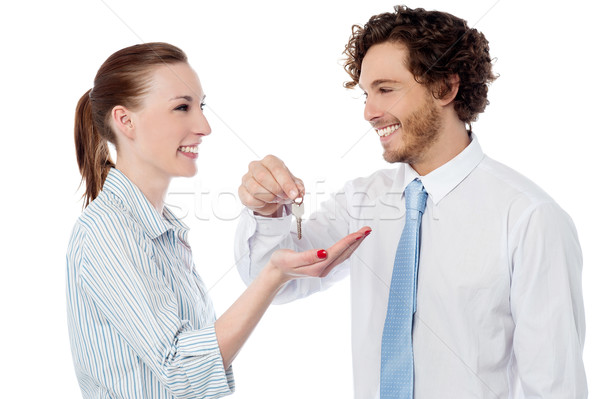 Businessman handing over the key Stock photo © stockyimages
