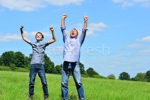 熱狂的な 父から息子 屋外 歓喜 公園 子供 ストックフォト © stockyimages