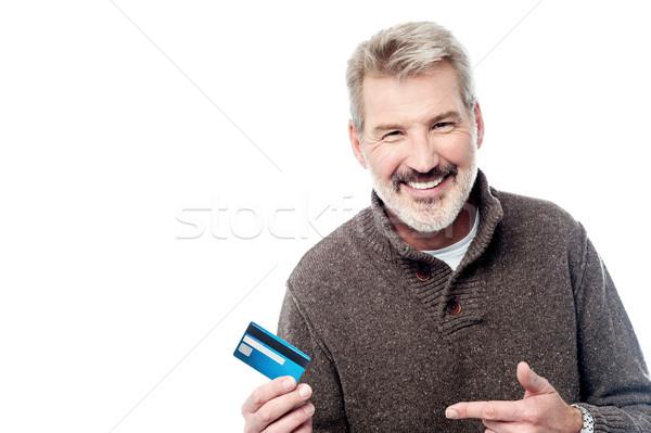 笑みを浮かべて 男 デビットカード 成熟した男 ストックフォト © stockyimages