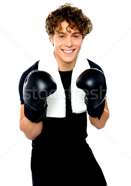 Boxer boy in sports outfit ready to punch you Stock photo © stockyimages