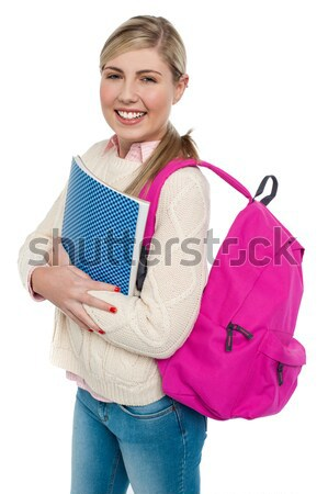 Excited woman posing with hands on chin Stock photo © stockyimages