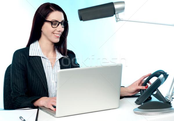 Female secretary answering phone call Stock photo © stockyimages
