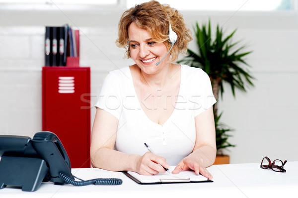 Vrolijk uitvoerende werk schrijven beneden Stockfoto © stockyimages