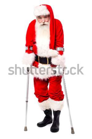 Confident Santa with a big belly posing sideways Stock photo © stockyimages