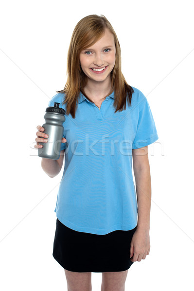 Teen in sports wear posing with a water bottle Stock photo © stockyimages
