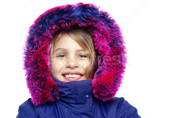 Cheerful young girl in hooded fur jacket Stock photo © stockyimages