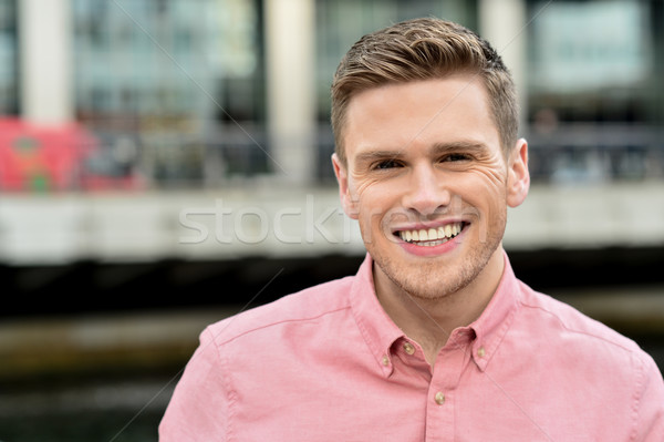 Handsome young man posing casually Stock photo © stockyimages