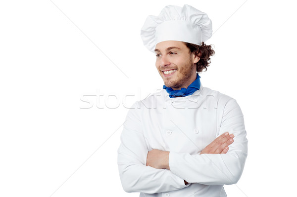 Smiling young male chef posing confidently  Stock photo © stockyimages