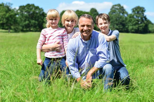 Stock photo: Happy family having fun at outdoors