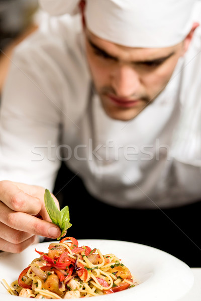 Chef garnishing pasta Stock photo © stockyimages