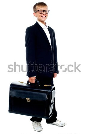 Full length portrait of cute boy carrying a briefcase Stock photo © stockyimages