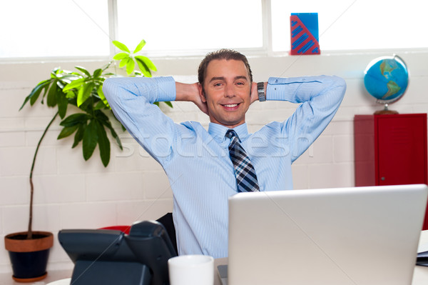 Manager relaxing in his office, work break Stock photo © stockyimages