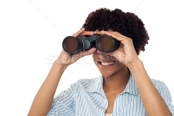 Woman watching through binoculars Stock photo © stockyimages