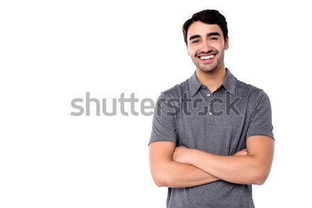 Jóképű fiatal derűs fickó lezser ruházat Stock fotó © stockyimages