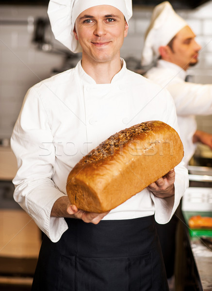 Chef showing freshly baked whole grain bread Stock photo © stockyimages