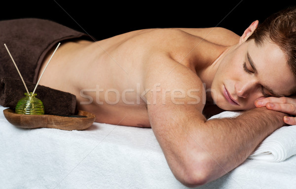 Young man in spa massage salon Stock photo © stockyimages