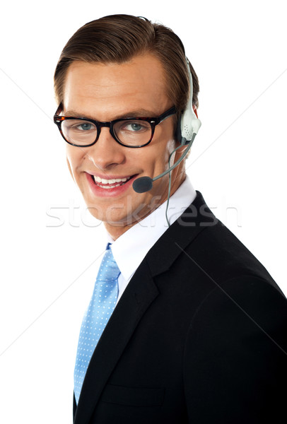 Smiling telemarketing male executive, closeup shot Stock photo © stockyimages