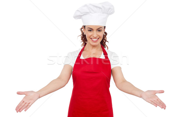 Smiling woman chef welcoming you Stock photo © stockyimages