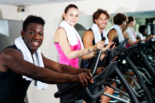 Energetic group working out together Stock photo © stockyimages