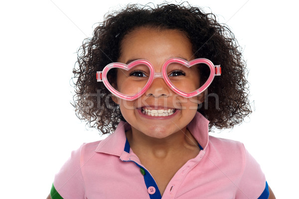 Pretty girl with a wide grin. Wearing funny frame Stock photo © stockyimages